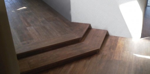 This wrapped wooden step-down following the wall's angle really helps form happily follow function.